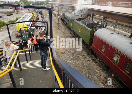 "Newly restored LNER A3 class locomotive ""Flying Scotsman"" at York station after taking on water for a journey to - Stock Photo"