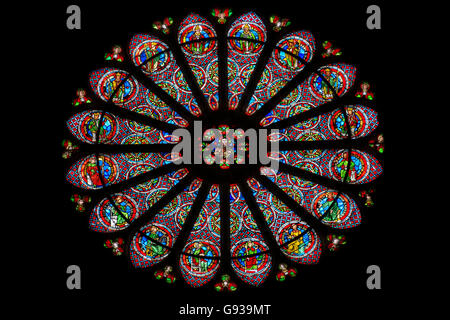 The rose window of the basilica of Saint-Remi - Stock Photo