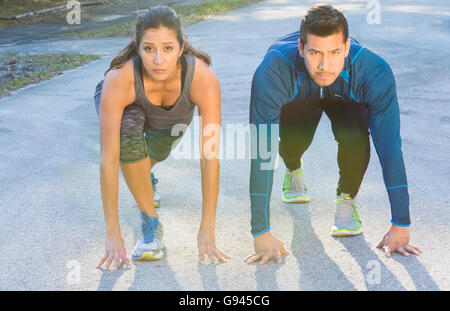 Young Hispanic Spanish couple competition running starting line tense winning contest Model Released, MR-14, MR - Stock Photo