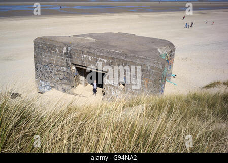 Old WWII German bunkers and gun emplacements at Bray Dunes in Dunkirk France - Stock Photo