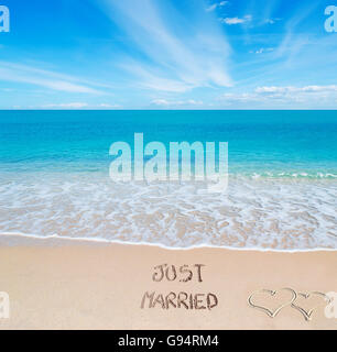 'just married' written on a tropical beach - Stock Photo