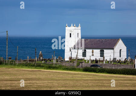 Ballintoy Parish Church is the main Church of Ireland church of the small town of Ballintoy, County Antrim, Northern - Stock Photo
