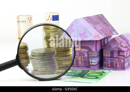 Real estate concept with Euro bill House and expenses under magnifying glass - Stock Photo