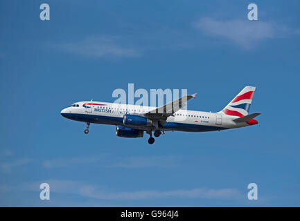 British Airways Airbus 320-232 Registration G-EUUK over London Heathrow Airport.  SCO 10, 463. - Stock Photo