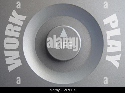 Life dial inbetween work and play choices - Stock Photo