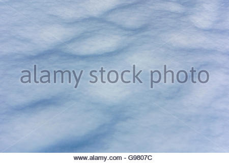 Winter shadows on surface of snow. pattern season snowfall blue texture season snowfall blue - Stock Photo
