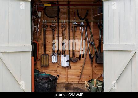 Close up of garden shed, double doors open.Garden tools, equipment. - Stock Photo