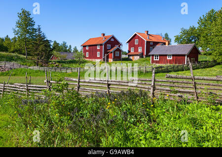 Old rural farm on a hill in the countryside - Stock Photo
