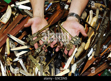 Lothian and Borders Police Constable Stephen McGill from the Safer Communities Department displays a collection - Stock Photo