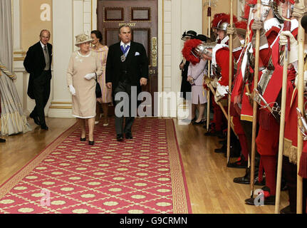 Left to right: The Duke of Edinburgh, Britain's Queen Elizabeth II and the Lord Mayor of London David Brewer arrive - Stock Photo