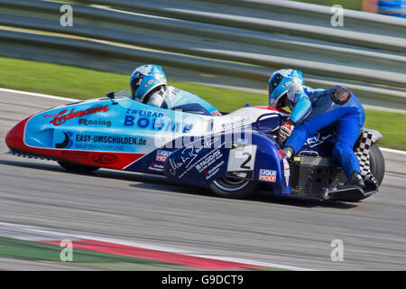 Motorcycle racers Mike Roscher and Danny Kamerbeek, Germany, compete in the Sidecar cup on August 21, 2011 in Zeltweg, - Stock Photo