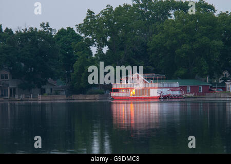 Early morning sun reflects off a river boat on the St. Joe River. - Stock Photo