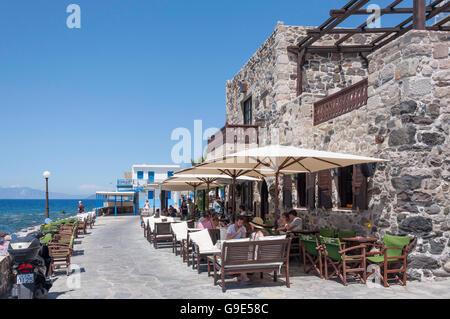 Waterfront tavernas in Mandraki, Nisyros (Nissyros), The Dodecanese, South Aegean Region, Greece - Stock Photo