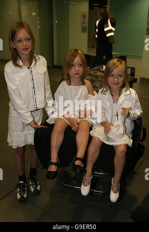 Irish children (left to right) Clara, Shauna and Emily Murphy arrive home to Dublin airport after they were evacuated - Stock Photo