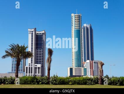 Manama, Bahrain. New hotels and apartments in rapidly developing Seef area. L-R S Hotel, The Breaker, Era Tower - Stock Photo