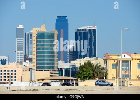 Manama, Bahrain. Seef district. Looking east to the Ramee Grand Hotel and the Almoayyed Tower aka the Dark Tower - Stock Photo