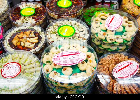 The famous Hussain Mohammed Showaiter Sweets shop. Muhurraq, Bahrain. Traditional rosewater, sesame, pistachio halva - Stock Photo