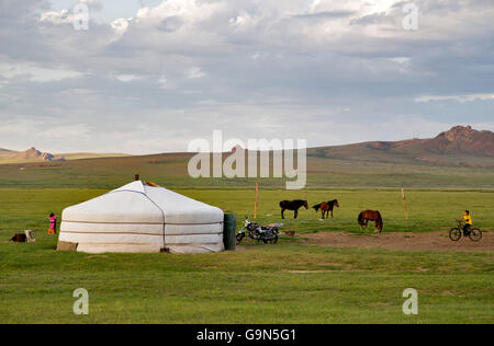 Stunning view of Steppes of Mongolia. Traditional tent and horses. - Stock Photo