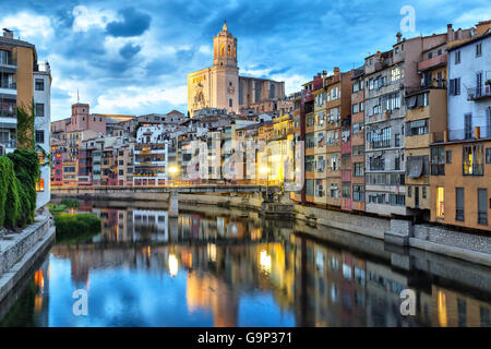 Cathedral and colorful houses on the side of river Onyar in the evening, Girona, Catalonia, Spain - Stock Photo