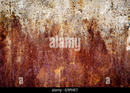 Very old dark orange rust stains on an aged metal surface. The patterns are formed by heavy oxidization. - Stock Photo