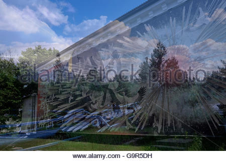 Exterior mural of a museum commemorating the Chernobyl nuclear disaster depicting  an exploding reactor core and - Stock Photo