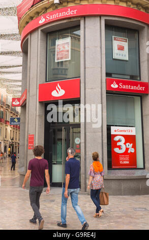 Malaga, Costa del Sol, Malaga Province, Andalusia, southern Spain.  Branch of Banco Santander in Calle Larios. - Stock Photo