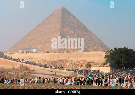 The Great Pyramid of Giza, solar barge, tourists, Pyramids of Giza, Giza, Egypt / Pyramid of Khufu - Stock Photo