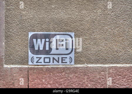 wifi sign on a rustic wall. Processed for hdr tone mapping effect. - Stock Photo