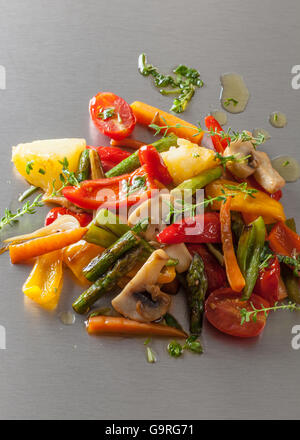 Grilled vegetables with spicy oil on a Japanese teppanyaki grill plate. - Stock Photo