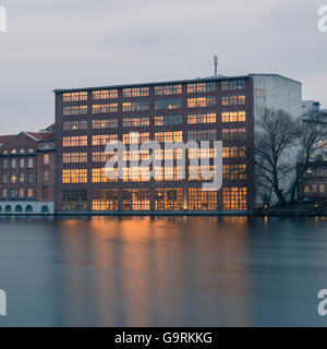 Berlin, Germany. January 15, 2014. Business Buildings located at Berlins River Spree. Longtime Exposure, HDR Look. - Stock Photo