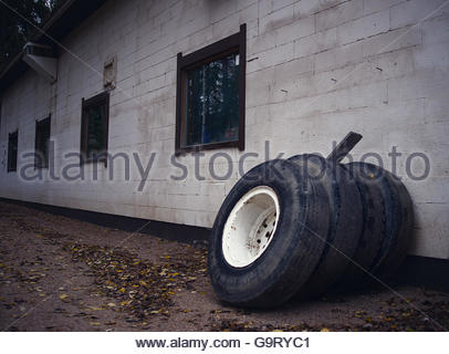 old tires waiting and nojata on garage wall stock photo