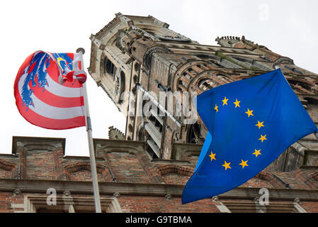 Bruges flag and European Union flag beneath the Belfort Tower in Bruges, Belgium. - Stock Photo
