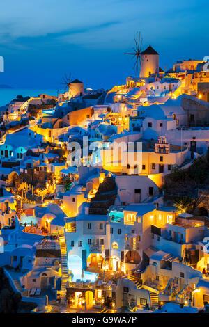 Lights of Oia village at night, Santorini, Greece. - Stock Photo