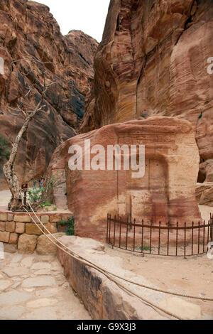 Nabataean baetyl, monument in the Siq, canyon, Petra Archaeological Park, Petra, Jordan, Asia Minor - Stock Photo