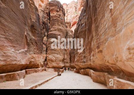 ancient watersupply in canyon, ancient pavestones, Siq of Petra, canyon of Petra Archaeological Park, Petra, Jordan, - Stock Photo