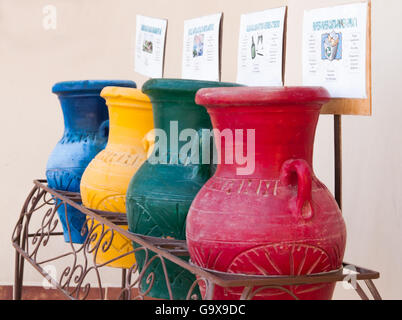 Colorful clay pots in a trash can at the hotel in Hurghada, Egypt - Stock Photo