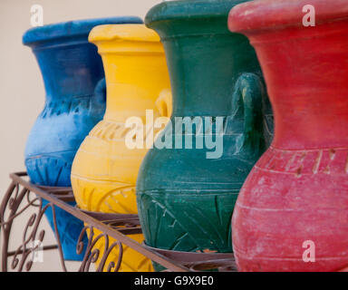 Colorful clay pots in a trash can at the hotel in Hurghada, Egypt. - Stock Photo