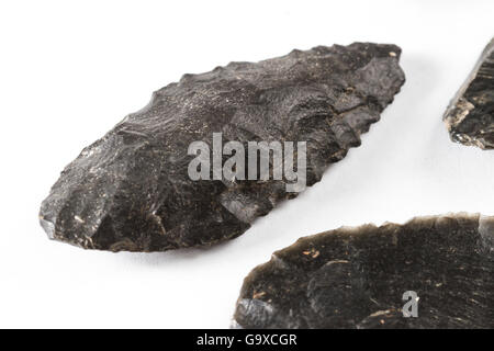 private collection of native american arrow heads with identifiable rudimentary tool marks - Stock Photo