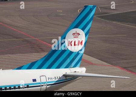 AMSTERDAM, THE NETHERLANDS - FEBRUARY 18, 2015 Rear of an old klm boeing 737 parked at schiphol Airport - Stock Photo