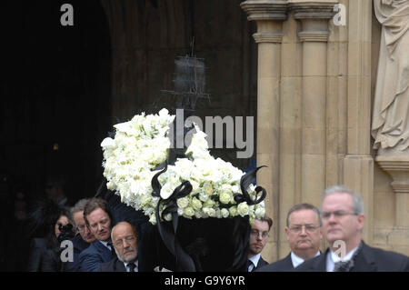 Pall-bearers carry the coffin of Isabella Blow out of Gloucester Cathedral during her funeral service.
