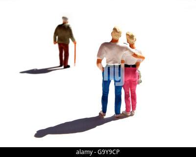 Miniature figurines, couple watching elderly man - Stock Photo