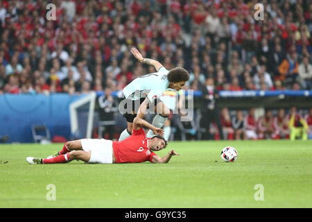 Lille, France. 1st July, 2016. Hal Robson-Kanu (Bottom) of Wales vies with Axel Witsel of Belgium during the Euro - Stock Photo