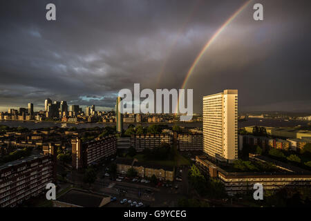 London, UK. 1st July, 2016. UK Weather: Colourful rainbow breaks during a brief evening rainstorm over south east - Stock Photo