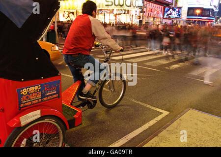 Rickshaw, bicycle cabby, Times Square, 42nd Street, New York City, New York, USA - Stock Photo