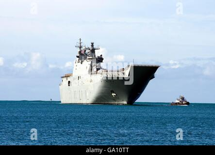 Royal Australian Navy Canberra-class landing helicopter dock ship HMAS Canberra pulls into Pearl Harbor for the - Stock Photo
