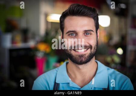 Portrait of male florist smiling - Stock Photo