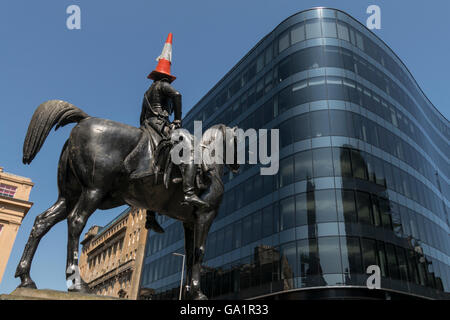 Statue of Duke of Wellington with traffic cone on head, facing modern office block, Glasgow, Scotland, UK, - Stock Photo