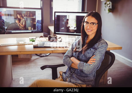 Happy graphic designer sitting at office - Stock Photo