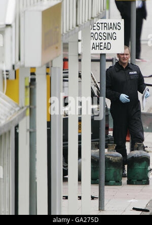 Forensic police officers at Glasgow Airport this morning following a dramatic attack on the terminal building yesterday.