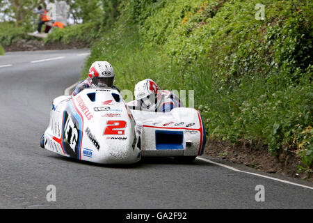 Ben and Tom Birchall on their way to winning the 2016 Isle of Man Sidecar TT race. - Stock Photo